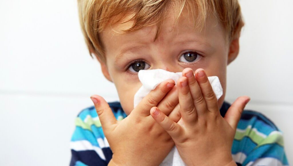 Kids blowing nose